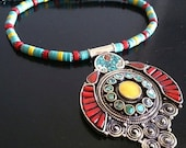 Antique Tibetan style necklace with embedded turquoise and coral pendant and disc beads