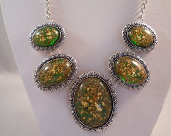 Silver Tone Bib Necklace with Gold and Shades of brown and Green Oval Pendants on a Silver Chain