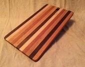 Multi-wood striped cutting board