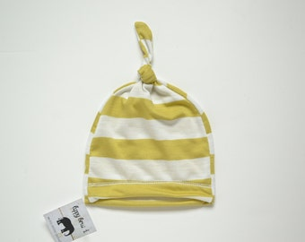 Newborn neutral hat. Knot top style, adjustable. Chartruse and white colors. Made by lippybrand.