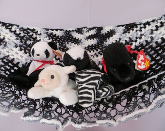 Crochet toy net hammock in black, white and gray with coordinating ruffle trim, stuffed animal storage