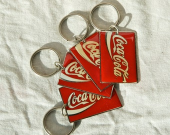 Four 1990 Coca-Cola keychains…Coke key chains.