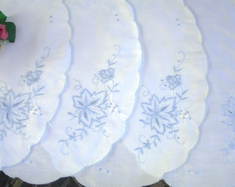 Embroidered Placemats Chargers set of Four Blue and White circa 1980s