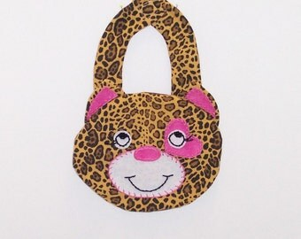 Little Leopard Baby Bib ... Hand and Machine made with all new materials ... Layered with fleece for comfort ... Velcro Closure.