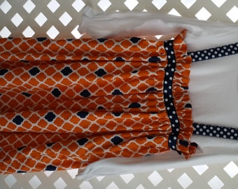 Auburn dress or tunic top with shirt.  Shirt can be long sleeved or short sleeved.
