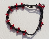 Bracelet macrame black waxed cord interwoven with red glass beads handmade gift