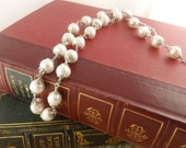 """Perfect Pearl VII:Wire-wrapped Plump White """"Potato"""" pearls are joined in hand-wrapped spirals of sterling silver wire"""