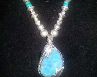 Opal pendant -- necklace. Gorgeous blue Australian opal with iridescent green