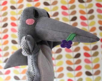 Dolphin hand puppet with flower