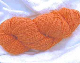 5.5oz Jamieson & Smith Shetland wool yarn, 2 ply, in a light orange (color 38)