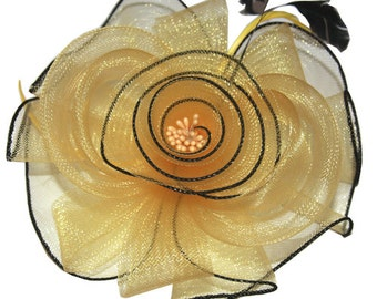 Yellow Flower Headband Fascinator accented with feathers.
