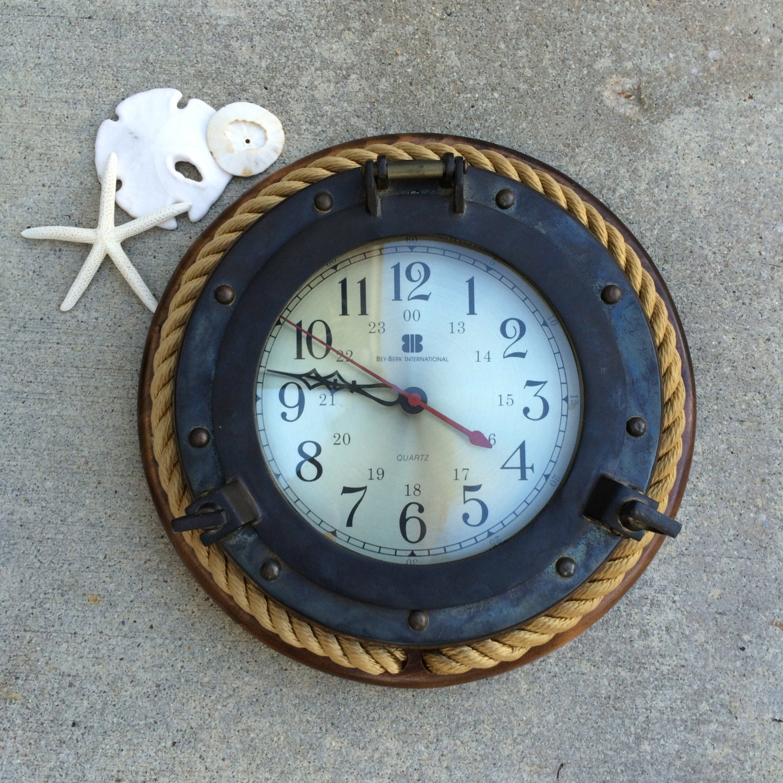 Sale nautical wall clock bey berk international port hole for Seashell wall clock