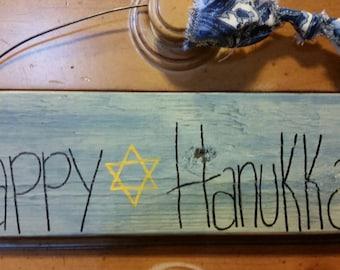 Happy Hanukkah sign.  Primitive. Star of David.