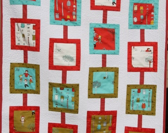 Handmade quilt featuring Little Apple Trees by Aneela Hoey for Moda Fabrics in crisp colors of aqua, red and khaki set against white