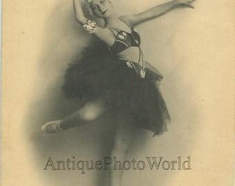 Beautiful Russian girl ballerina in beautiful costume antique dance photo