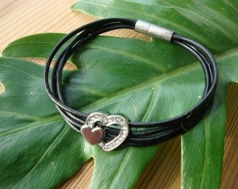 Black leather bracelet with crystal heart charm bead