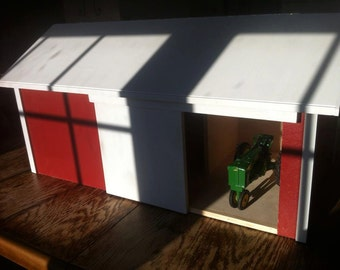 Toy machine shed for tractors.