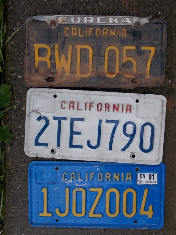 three california state license plates 1963 black yellow 1991 blue yellow no tag