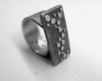 Sterling silver adjustable, oxidized parallelogram ring with dots motif. Ready to ship