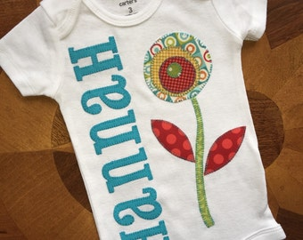 Appliqued Personalized name baby onesie with a flower