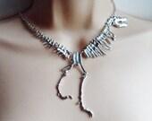 Silver T-rex dinosaur skeleton necklace
