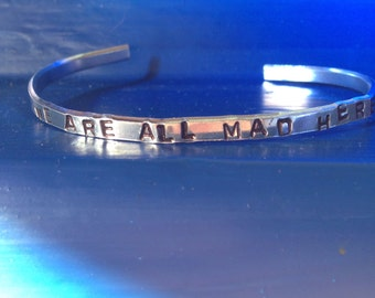 We are all mad here - alice in wonderland hand stamped metal cuff