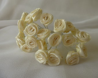 Satin ribbon flowers.  10 roses per bunch.   Each flower is approximately 15mm across