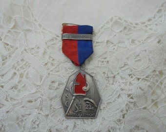 Vintage enamel medal with ribbon