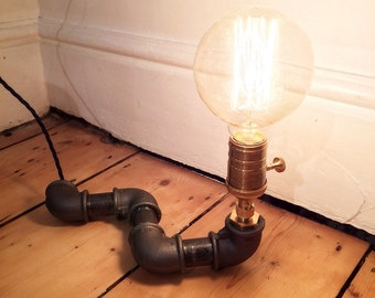 Black steel pipe lamp with edison bulb and brass fittings