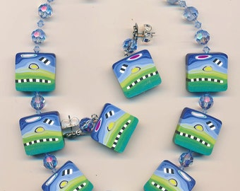 Necklace and earring set made with very cool polymer clay beads by Terri Stone of TLSclaydesign and Swarovski crystals