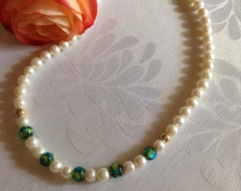 Freshwater pearl and foiled glass bead necklace with gold plate fittings.