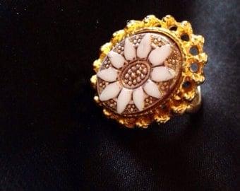 Golden flower statement ring