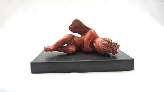 Ceramic idol of winged love, Terracotta Greek statue of Eros, Museum greek statuette