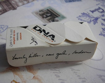 vintage Bijan DNA eau de parfum sample for women. Boxed fragrance sample.  Paper ephemera.