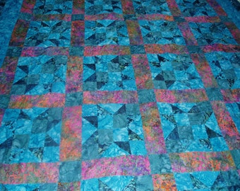 Lap quilt in turquoise star pattern Hand Quilted custom colors available