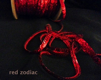 red zodiac (hologram) sequin trim--non-stretch and stretch