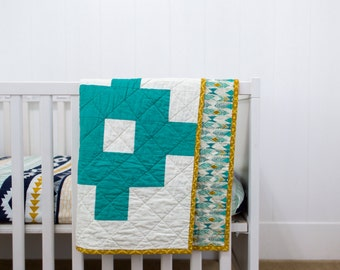 SALE - Teal Aztec with gold accent back crib quilt