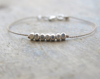 Fine silver minimalist bracelet with nugget beads on a brown silk thread