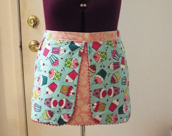 Apron, reversible apron, half apron