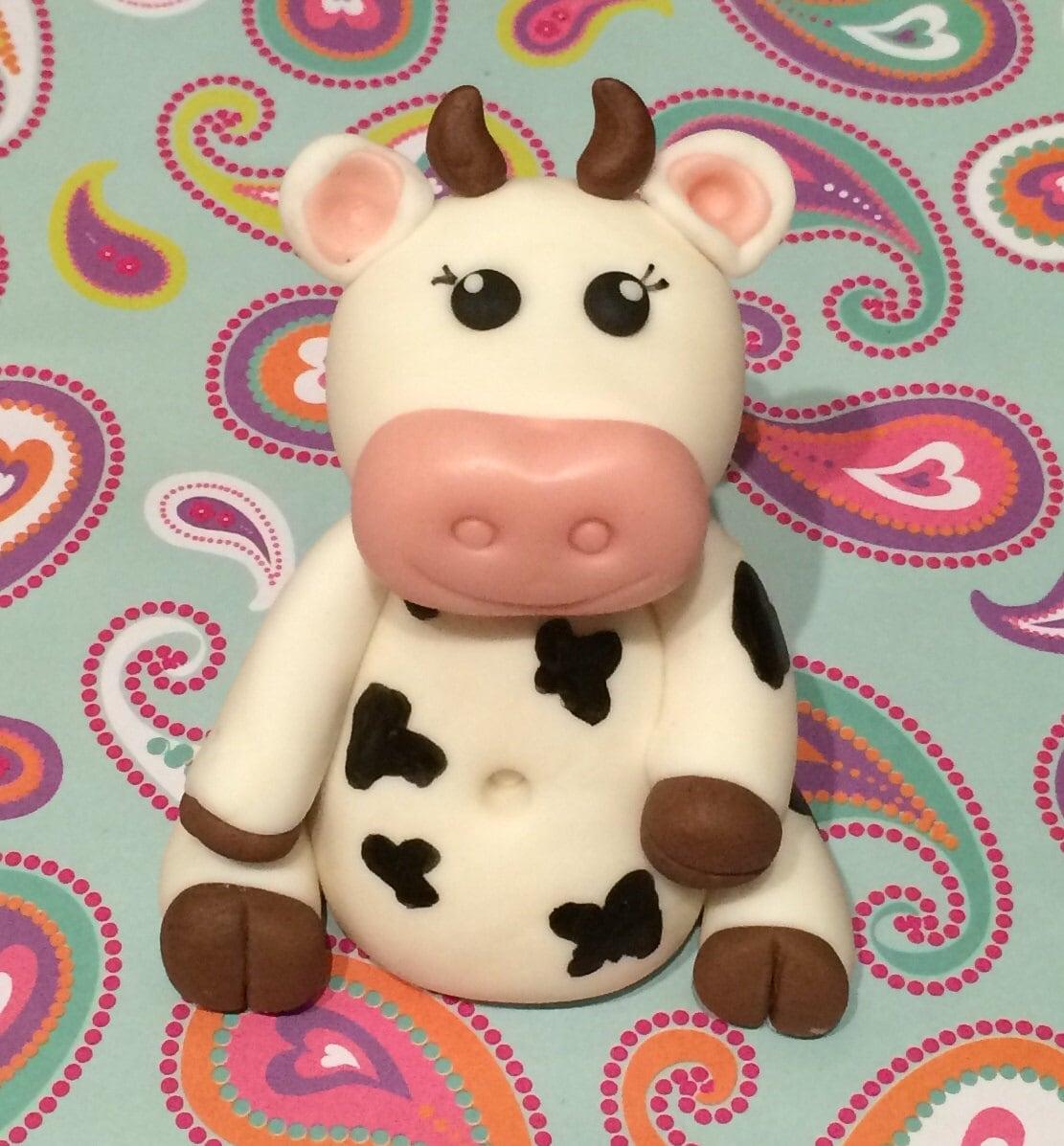 Cow inspired fondant cake topper