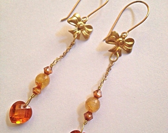 Crystal Hearts and Brass Bows Dangle Earrings