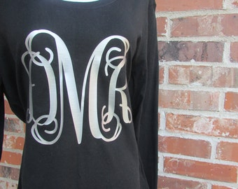 Gorgeous ladies black, scoop neck, long sleeve tee.  Beautiful soft foil monogram to complete your awesome look.