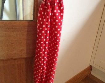 Red and white polka dot carrier bag holder