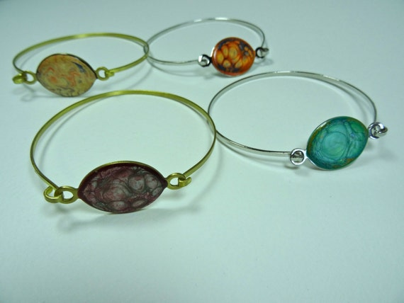Enamel-like brass or silver-color metal self-closing bangles with abstract designs (multi-colors)