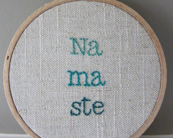 "Hand-Embroidered 4"" Hoop Art Ombre Teal ""Namaste"" Saying on Oatmeal Linen Cotton Blend Fabric"