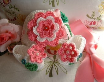 Crocheted hat and handmade shoes in white cotton with pink flowers applied. Crochet fashion baby summer