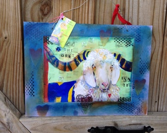 Mixed media photo collage Bill the Goat.  Photo of iriginal painting collaged onto wood with painted border.