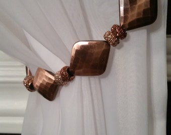Beaded drapery tie-back with copper and glimmery beads, on copper wire. Edgy and glam for your curtains!