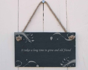 A Natural Slate Hanging Sign etched with the message 'It takes a long time to grow an old friend' (SR340)