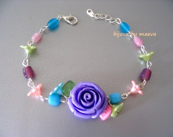 costume jewelry bracelet flower resin beads and lilac, green, turquoise and pink
